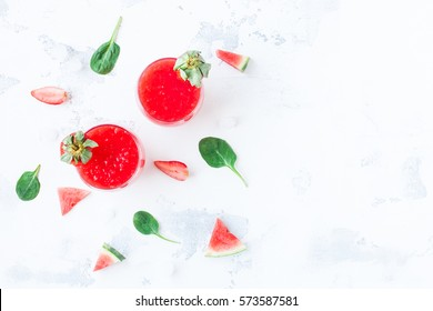 Summer cocktail with watermelon and strawberry on white background. Top view, flat lay