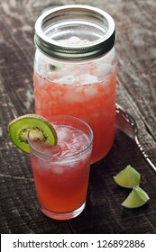 Summer cocktails strawberry daiquiri with kiwi garnish