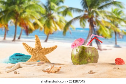 summer coconut cocktail on tropical beach.
