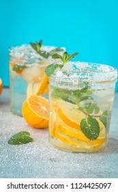 summer cold drink lemon cocktail on blue