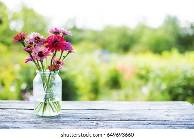 Summer colorful flowers on rustic table