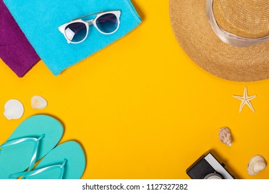 Summer composition of beach accessories and seashells top view