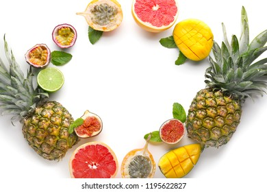 Summer composition with tropical fruits on white background