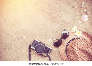 Summer concept with accessories on sand beach.