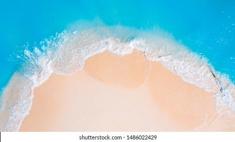 Summer concept background, ocean beach with wave and sand on a tropical island