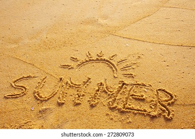 Summer concept of beach with word summer written on the sand