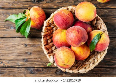 Summer concept. Fresh sweet peaches on the wooden table, selective focus