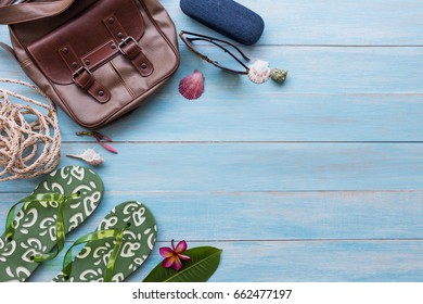 Summer concept with men's accessories items on blue rustic wooden board background