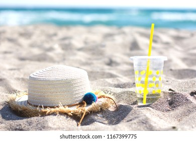 Summer concept with sandy beach and swimming accessories. Sea on background.