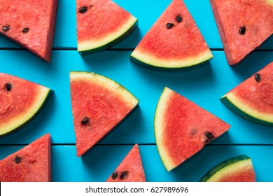 Summer Concept Sliced Watermelon On Blue Rustic Wood Background