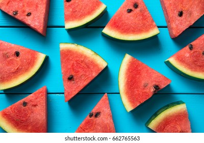 Summer concept : Sliced watermelon on blue rustic wood background.