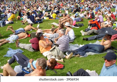 Summer concert crowd relaxing at hyde park London.
