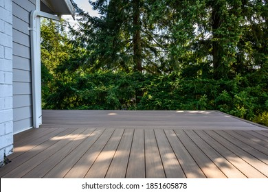 Summer construction, outdoor deck under construction, new manufactured wood planks installed
