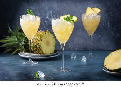 Summer cool cocktail with pineapple, ice and mint, selective focus image