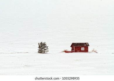 The summer cottages at the beach in Kalajoki, Finland don't look too tempting in a snow storm. The Bothnic Gulf is covered with ice.