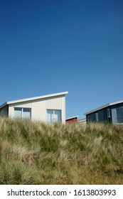 Summer cottages, several coloured wooden houses in the dunes, Hörnum, Sylt, Schleswig-Holstein, Germany