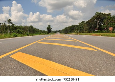 Summer Country Road With Trees Beside and cloud  Concept. asphalt road through the green field and clouds on blue sky in summer day.