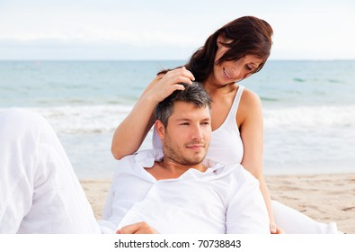 Summer couple smiling laughing on the blue beach