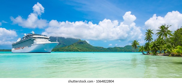 Summer cruise vacation travel. Luxury cruise ship anchored close to exotic tropical island. Panoramic landscape view of Bora Bora.