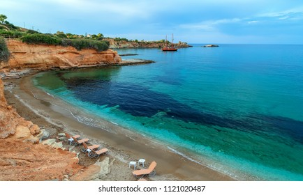 Summer day at beautiful lagoon with blue water and colorful bottom of Hersonissos on the island of Crete in Greece.