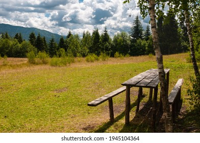 Summer day in the Carpathians.A picnic spot on the mountain.Blue sky in white scenic clouds.