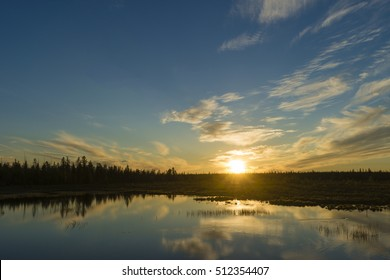Summer day landscape with river, forest, clouds on the blue sky and sun. Sunset, sunrise, sunset, sunrise, sunset, sunrise,