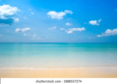 Summer day Phuket beach sea sand and sky. Landscape view of beach sea in summer day. Beach space area. At Karon Beach, Phuket, Thailand. On 15 December 2020