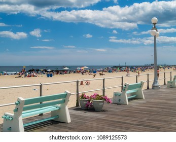 A summer day view of the beach and boardwalk in Avon by the Sea along the Jersey Shore.