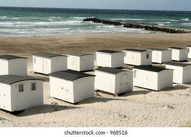 summer in denmark:beach of loekken, beach houses in line