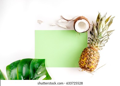 summer dessert with pineapples and coconut on white background top view mock up