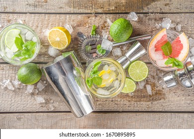Summer detox beverage  concept. Citrus fruit drinks with ice. Healthy diet cocktail with making bar tools.  Vitamin fortified water