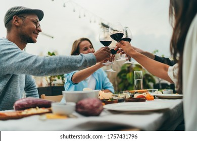 Summer Dinner Party Outdoors, Group of people making cheers with red wine glasses celebrating birthday of best friend at cafe terrace their favorite spot , Friendship Meeting Hang Out Restaurant
