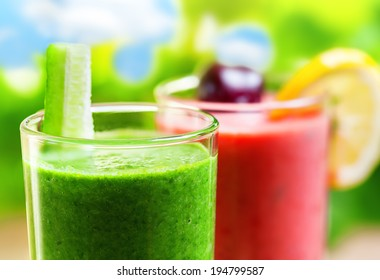 Summer drink, green and pink smoothies, outdoor