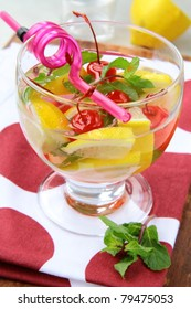 summer drink sangria with fruit in a large glass