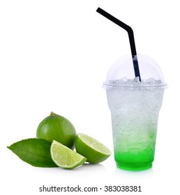 Summer drinks with ice and lime on white background