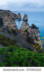Summer evening Atlantic ocean rocky coast (along coastline of Lagos town, Algarve, Portugal).