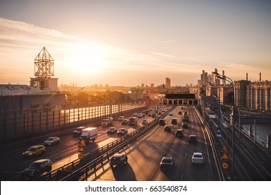 Summer evening cityscape photography Moscow city car traffic, amazing sunset above wide road with cars and modern Moscow skyscrapers. Russia outdoor landscape, Moscow. Moscow city panorama at sunset