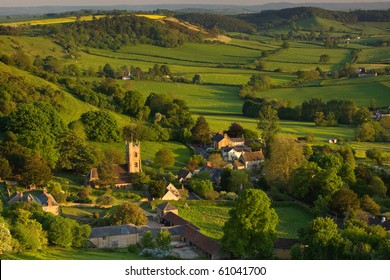 A summer evening view down onto the village of Corton Denham, Somerset, UK