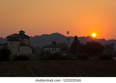 Summer evening in the village, was seen in Vicenza, Italy. Sunset in the late evening with a church in background.