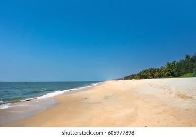 Summer exotic sandy beach Kerala. empty exquisite ocean
