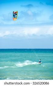 Summer extreme sports. Kite surf activity of professional athlete