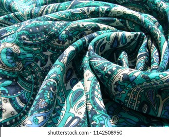 Summer fabric with bright ornament. Texture of fabric.