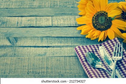 Summer or Fall Picnic Place setting with Sunflower on Rustic Wood Board Background with Room or space for copy, text, your words.  Horizontal instagram