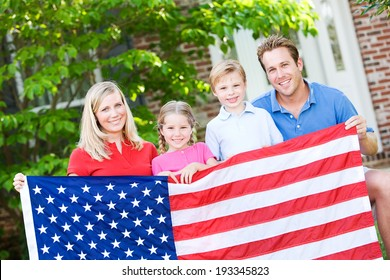 Summer: Family Posing Outdoors With American Flag