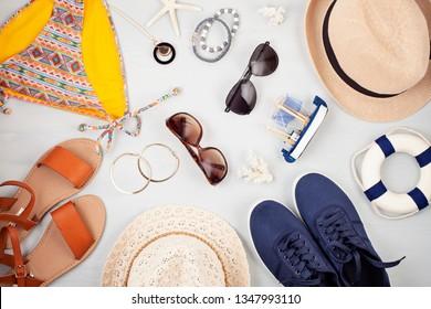 Summer family vacation, travel, tourism concept flat lay. Beach, countryside, casual urban accessories for guys and girls top view