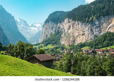 Summer in the famous Lauterbrunnen valley, Berner Oberland, Switzerland, Europe. Dramatic cliffs surrond the town with the the iconic Staubbach waterfall adding to the stunning backdrop.