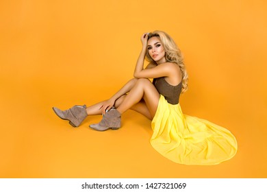 Summer fashion. Fashionable women in trendy yellow dress, shoes and accessories. Fashion spring summer photo. Happy young girl on a yellow background in studio - Image.Image