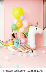 Summer Fashion Girls Having Fun With Balloons On Unicorn Float