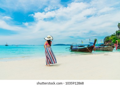 Summer fashion lifestyle traveler woman in big hat joy relaxing on Ao nang  beach 0654dd62393b7