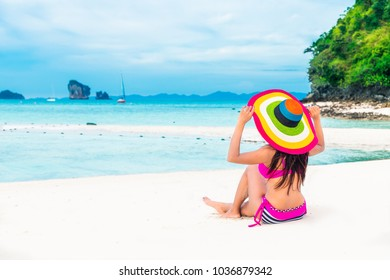 Summer fashion lifestyle traveler woman in bikini joy relaxing on natural sea beach, Tub island, Andaman, Krabi, Travel Thailand, Beautiful destination landscape Asia, Holiday outdoor vacation trip